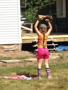 That is my baby girl extending out to Thrusters at the cabin with a little log I found her this summer. We worked out together almost every day. It was awesome.